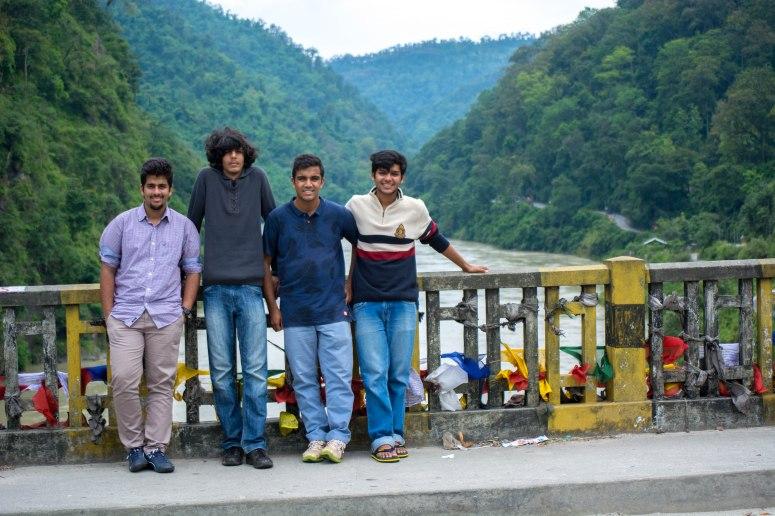 On a bridge over the Teesta River.