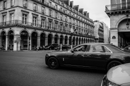 A Rolls-Royce speeding through Rue de Rivoli.