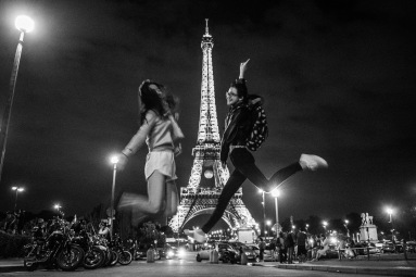 Two of my friends in front of the Eiffel Tower at midnight.